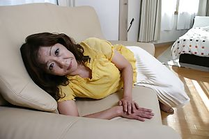 Granny Japanese Eriko Nishimura strips down to get her pussy while