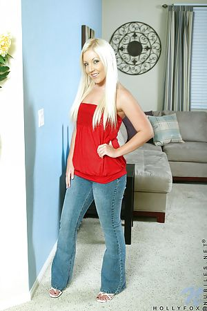 Irresistible Nubile Hollyfox sexily posing and looks hot on her red