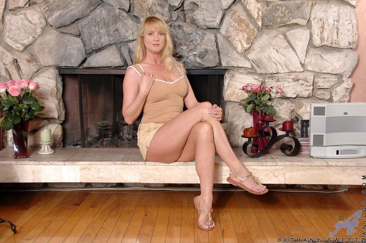 youngrussian hairypussy blonde Bethany Sweet shows some up skirt views of her hairy pussy before teasing  it with a magic wand