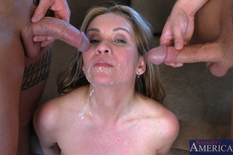 Hot MILF fucks two cocks and loves swallowing cock while she is fucked from  behind.
