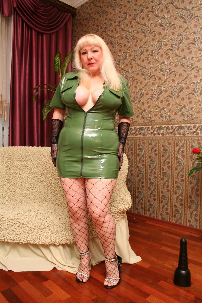 Girl stuffs huge dildo in pussy